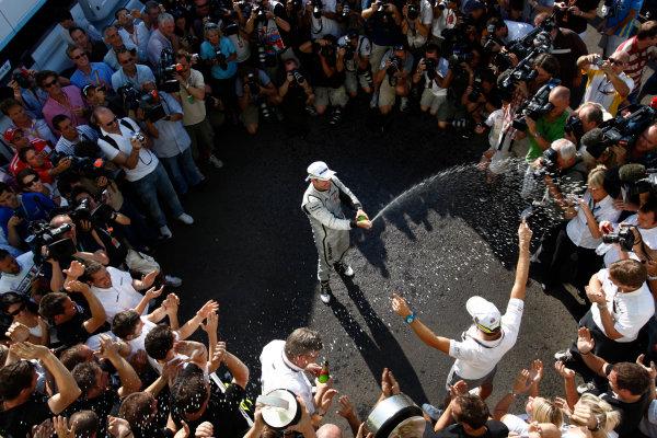 Autodromo Nazionale di Monza, Monza, Italy. 13th September 2009. Rubens Barrichello, Brawn GP BGP001 Mercedes, 1st position, celebrates with the Brawn GP team. Portrait. World Copyright: Andrew Ferraro/LAT Photographic ref: Digital Image _H0Y4806