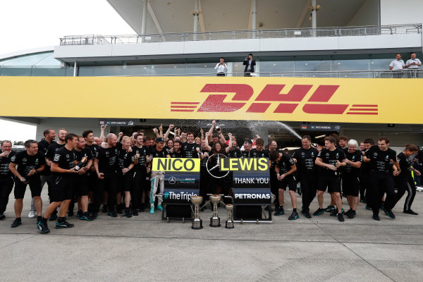 Suzuka Circuit, Japan. Sunday 9 October 2016. The Mercedes AMG team celebrate securing their 3rd consecutive constructors title. World Copyright: Dunbar/LAT Photographic ref: Digital Image _X4I8642