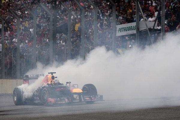 Interlagos, Sao Paulo, Brazil. Sunday 24rd November 2013.  Sebastian Vettel, Red Bull RB9 Renault, 1st position, celebrates victory with donuts. World Copyright: Andy Hone/LAT Photographic. ref: Digital Image _ONY0972