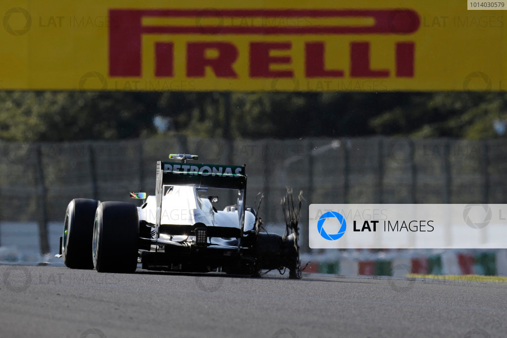 Suzuka Circuit, Suzuka, Japan.  Sunday 13th October 2013.  Lewis Hamilton, Mercedes W04, limps to the pits in the early stage of the race with a race ending puncture. World Copyright: Steve Etherington/LAT Photographic  ref: Digital Image JAP-RACE-4143 copy