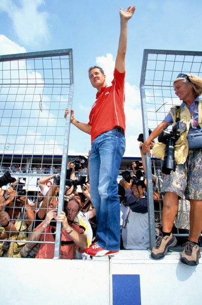 2004 German Grand PrixHockenheim, Germany. 23rd - 25th July.Michael Schumacher, Ferrari F2004 waves to the German fans after claiming pole position.World Copyright:Charles Coates/LAT Photographic Ref:35mm Image:A01
