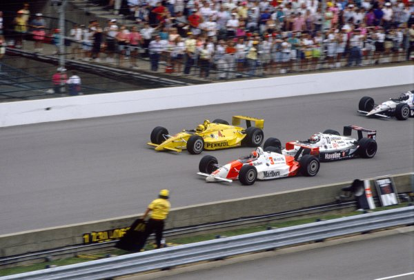 1991 Indianapolis 500.Indianapolis Motor Speedway, Indiana, United States. 26 May 1991.Rick Mears, Penske PC20-Chevrolet, 1st position, leads John Andretti, Lola T91/00-Chevrolet, 5th position, Michael Andretti, Lola T91/00-Chevrolet, 2nd position, and Al Unser jr, Lola T91/00-Chevrolet, 4th position.World Copyright: LAT PhotographicRef: 35mm transparency