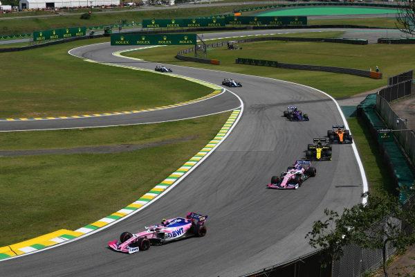 Lance Stroll, Racing Point RP19, leads Sergio Perez, Racing Point RP19, Nico Hulkenberg, Renault R.S. 19, Carlos Sainz Jr., McLaren MCL34, and Daniil Kvyat, Toro Rosso STR14