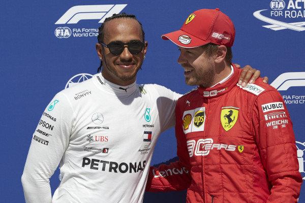 Front row starters Lewis Hamilton, Mercedes AMG F1, and pole man Sebastian Vettel, Ferrari