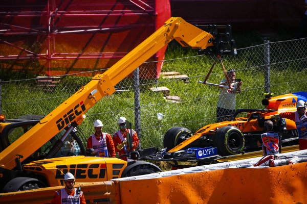 Car of Lando Norris, McLaren MCL34 being loaded on to the back of a low loader after a crash