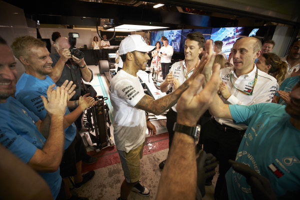 Lewis Hamilton, Mercedes AMG F1, 1st position, and the Mercedes team celebrate after a highly successful year of racing