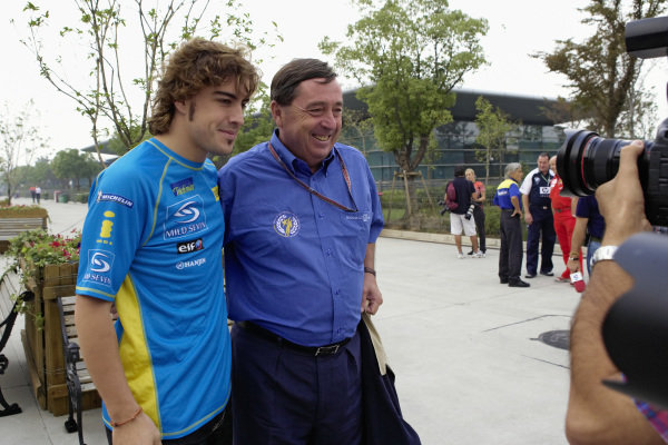 World Champion Fernando Alonso with Renault F1 Team chairman Patrick Faure.