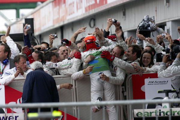 Rubens Barrichello celebrates 3rd position with his team in parc ferme.