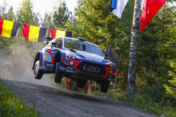 Thierry Neuville pitches his Hyundai sideways over a crest on Rally Finland