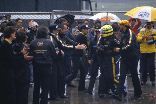 1985 Portuguese Grand Prix.Estoril, Portugal.19-21 April 1985.Ayrton Senna (Team Lotus) celebrates his maiden F1 win after an awesome drive in the rain soaked race. He is mobbed by team collegues, who haven't seen a victory at Lotus in nearly three years. Ref-85 POR 01.World Copyright - LAT Photographic