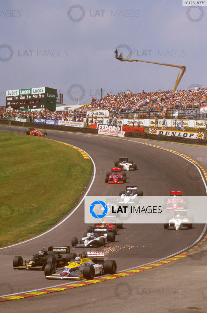 Brands Hatch, England.11-13 July 1986.Nigel Mansell (Williams FW11 Honda) 1st position exits Paddock Hill Bend at the start.Ref-86 GB 06.World Copyright - LAT Photographic