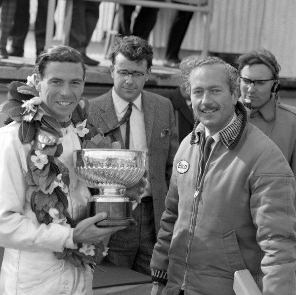 Race winner Jim Clark on the podium with Colin Chapman.