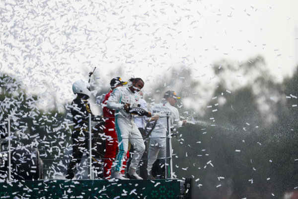 Race winner Lewis Hamilton, Mercedes AMG F1, Sebastian Vettel, Ferrari and Mario Achi, Mexican GP Promoter celebrate on the podium with the champagne