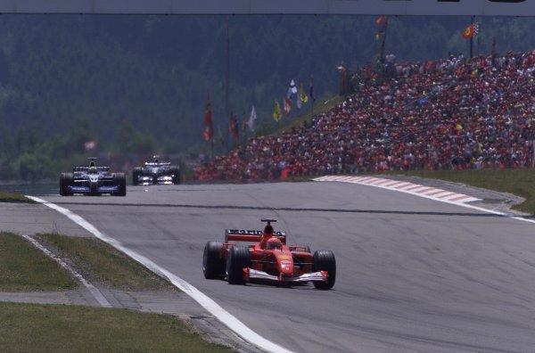 2001 European Grand Prix. RACENurburgring, Germany. 24th June 2001Race winner Michael Schumacher, Ferrari F2001, leads the two BMW Williams FW23 of Ralf Schumacher and Juan Pablo Montoya, action.World Copyright - LAT Photographicref: 8 9 MB Digital File Only