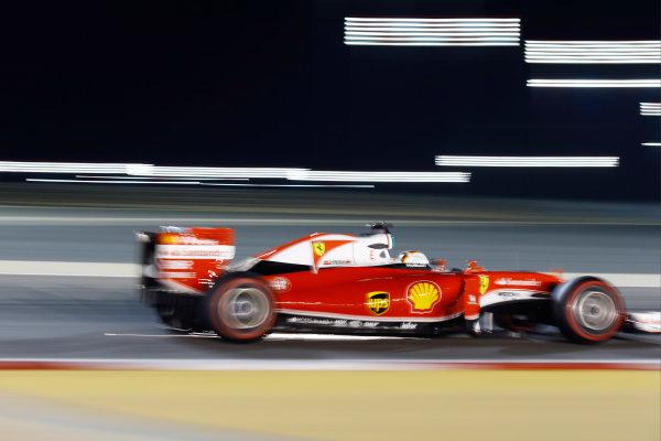 Bahrain International Circuit, Sakhir, Bahrain. Saturday 02 April 2016. Sebastian Vettel, Ferrari SF16-H, strikes sparks. World Copyright: Steven Tee/LAT Photographic ref: Digital Image _H7I0797