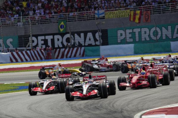 Fernando Alonso, McLaren MP4-22 Mercedes leads Lewis Hamilton, McLaren MP4-22 Mercedes and Felipe Massa, Ferrari F2007 at the start.