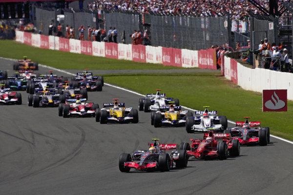 Lewis Hamilton, McLaren MP4-22 Mercedes leads Kimi Räikkönen, Ferrari F2007 and Fernando Alonso, McLaren MP4-22 Mercedes into the first corner.