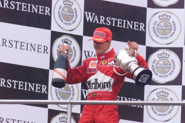 2000 European Grand Prix.Nurburgring, Germany. 19-21 May 2000.Michael Schumacher (Ferrari) celebrates 1st position on the podium.World Copyright - LAT Photographic