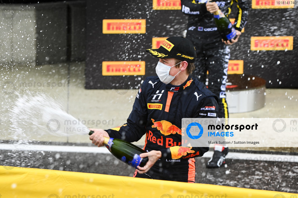 Race winner Liam Lawson (NZL, HITECH GRAND PRIX) celebrates on the podium with the champagne