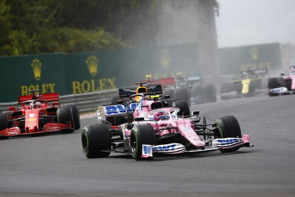 Lance Stroll, Racing Point RP20, leads Max Verstappen, Red Bull Racing RB16, and Sebastian Vettel, Ferrari SF1000