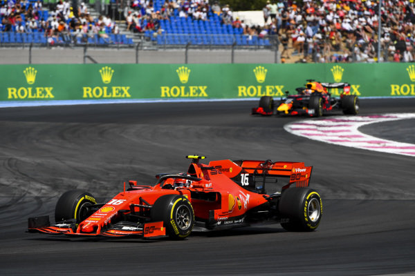 Charles Leclerc, Ferrari SF90 leads Max Verstappen, Red Bull Racing RB15