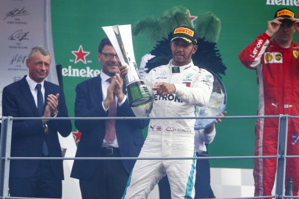 Lewis Hamilton, Mercedes AMG F1, 1st position, with his trophy on the podium.