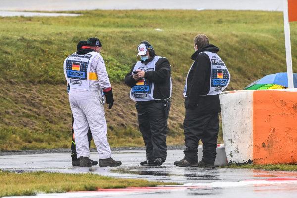 Marshals gather during the rain
