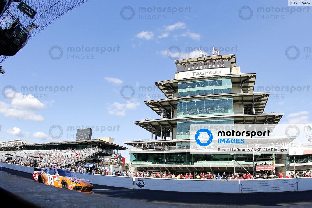 #18: Kyle Busch, Joe Gibbs Racing, Toyota Supra Combos drives under the checkered flag to win