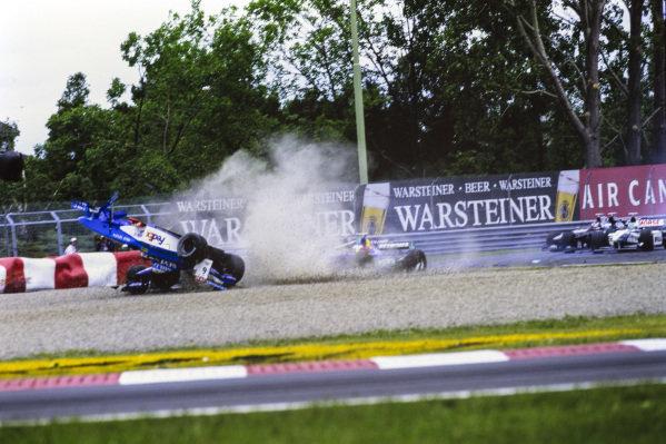 Alexander Wurz, Benetton B198 Playlife, flies upside down across the gravel after contact with Jean Alesi, Sauber C17 Petronas.