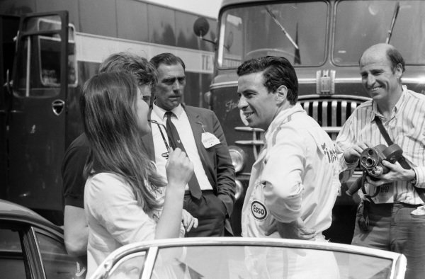 Jochen Rindt and Jim Clark in the paddock.
