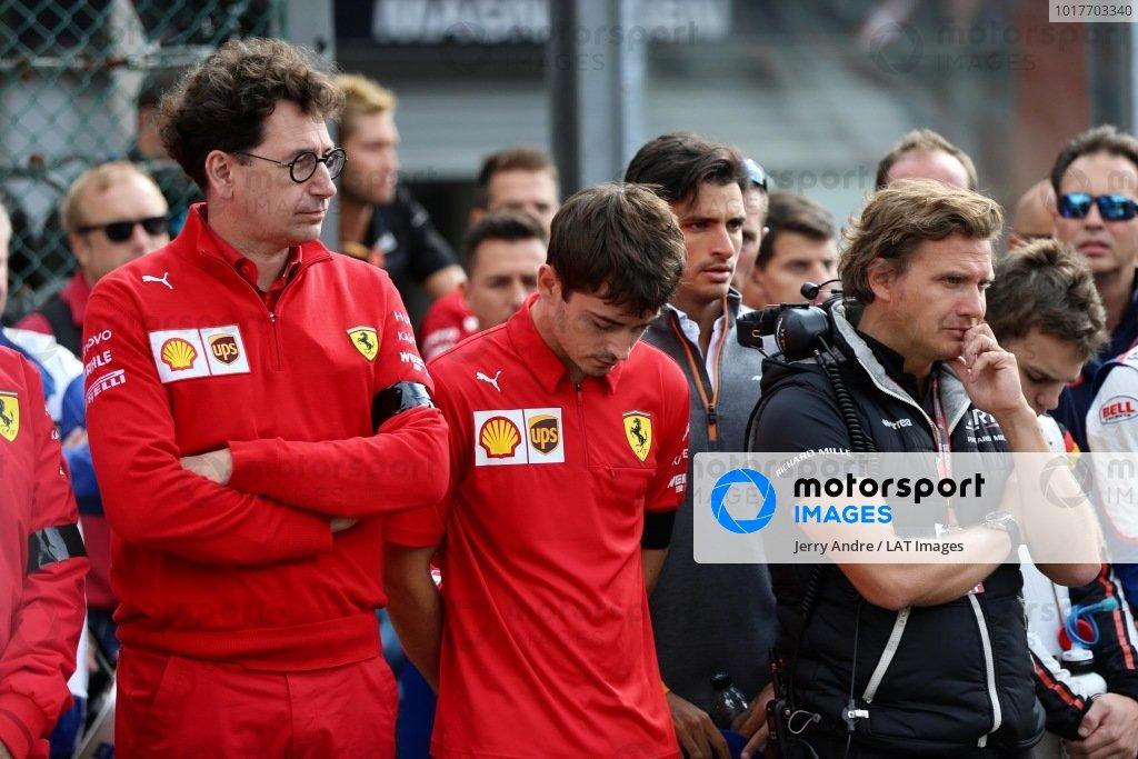 Mattia Binotto, Team Principal Ferrari, and Charles Leclerc, Ferrari, stand on the grid for the memorial of Anthoine Hubert (FRA, BWT ARDEN)