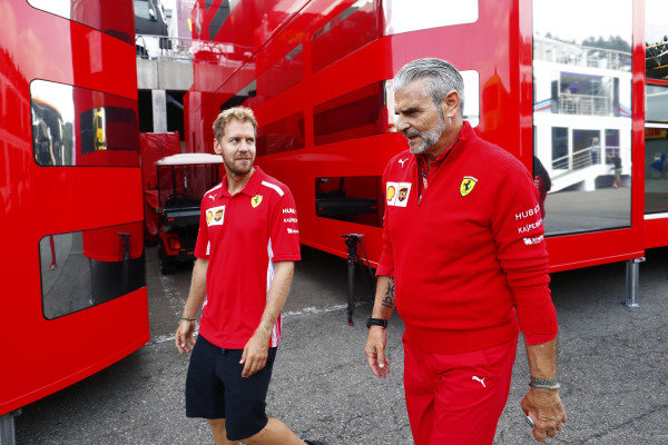 Sebastian Vettel, Ferrari, walks with Maurizio Arrivabene, Team Principal, Ferrari, in the paddock.