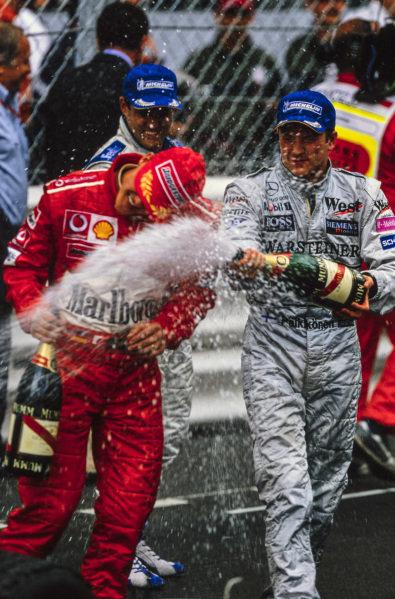 Kimi Räikkönen, 2nd position, celebrates with Michael Schumacher, 3rd position.