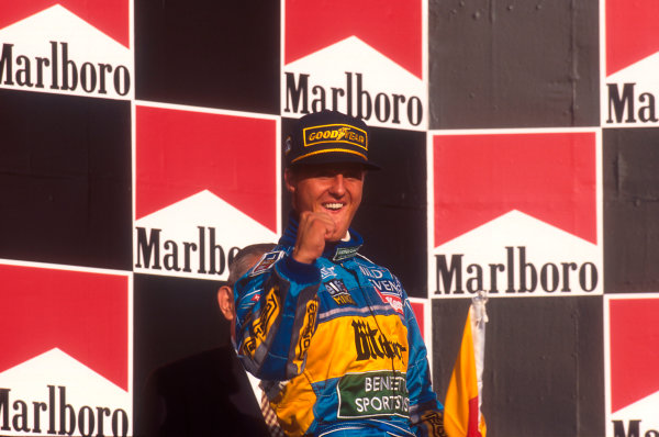 Tanaka International, Aida, Japan.20-22 October 1995.Michael Schumacher (Benetton Renault) 1st position, celebrates taking his second successive drivers world championship on the podium.Ref-95 PAC 07.World Copyright - LAT Photographic