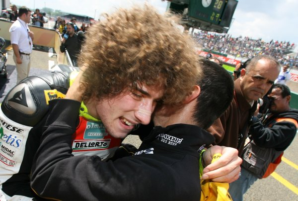 2008 MotoGP Championship - 250cc RaceLe Mans, France. 18th May, 2008.Marco Simoncelli Metis Gilera is congratulated after finishing 2nd in the 250cc race.World Copyright: Martin Heath / LAT Photographic