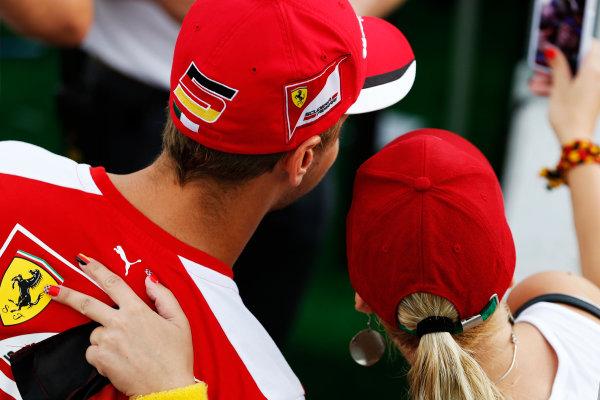 Hungaroring, Budapest, Hungary. Thursday 23 July 2015. Sebastian Vettel, Ferrari, has his picture taken with a fan. World Copyright: Charles Coates/LAT Photographic ref: Digital Image _J5R0794