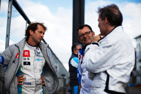 FIA Formula E Test Day, Donington Park, UK.  10th August 2015. Jarno Trulli (ITA), Trulli Formula E Team - Motomatica JT-01, talks with Jacques Villeneuve (CAN), Venturi VM200-FE-01  Photo: Sam Bloxham/FIA Formula E/LAT ref: Digital Image: _SBL9152