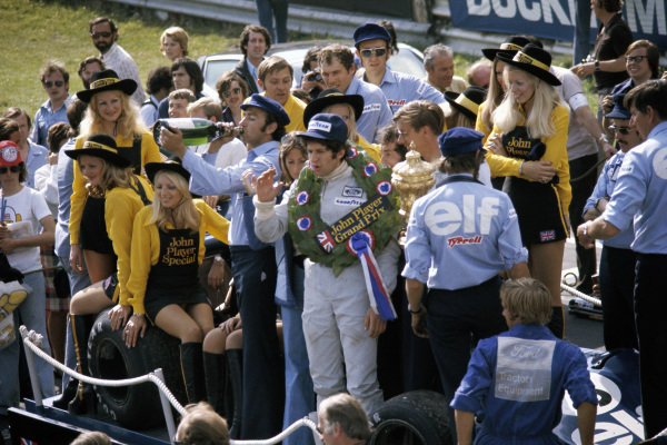 Honoury lap for race winner Jody Scheckter and the Tyrrell team, Jo Ramirez takes a sip of champagne.