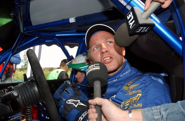 Petter Solberg (NOR), Subaru, is interviewed by Channel 4's Penny Mallory (GBR) at the finish line of the final stage.FIA World Rally Championship, Rd9, Neste Rally Finland, Jyvaskyla, Finland, Day 3, 10 August 2003.DIGITAL IMAGE