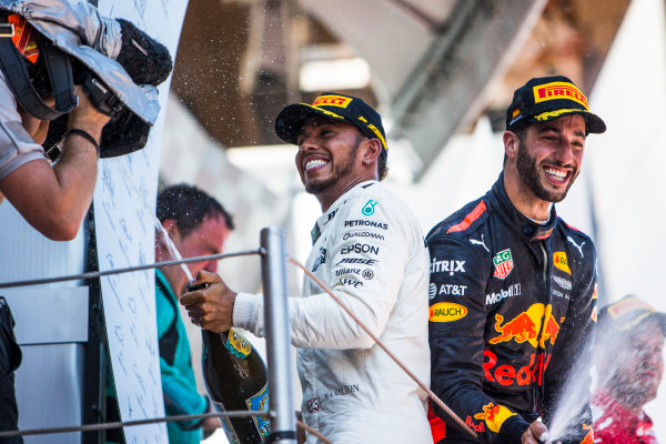 Circuit de Catalunya, Barcelona, Spain. Sunday 14 May 2017. Lewis Hamilton, Mercedes AMG, 1st Position, and Daniel Ricciardo, Red Bull Racing, 3rd Position, spray the Champagne on the podium. World Copyright: Dom Romney/LAT Images ref: Digital Image GT2R1888