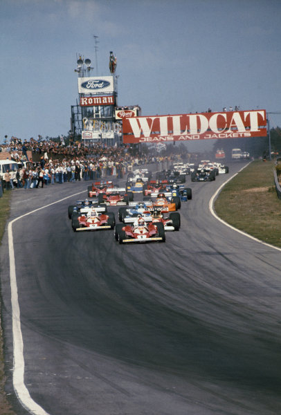 Zolder, Belgium. 14th - 16th May 1976. Niki Lauda (Ferrari 312T2), 1st position leads James Hunt (McLaren M23-Ford), retired, Clay Regazzoni (Ferrari 312T2), 2nd position and Jacques Laffite (Ligier JS5-Matra), 3rd position at the start of the race, action.  World Copyright: LAT Photographic. Ref: 76 BEL 07.