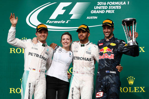 Circuit of the Americas, Austin Texas, USA. Sunday 23 October 2016. Nico Rosberg, Mercedes AMG, Victoria Vowles, Partner Services Director, Mercedes AMG, Lewis Hamilton, Mercedes AMG, 1st Position, and Daniel Ricciardo, Red Bull Racing, 3rd Position, on the podium. World Copyright: Glenn Dunbar/LAT Photographic ref: Digital Image _31I5294