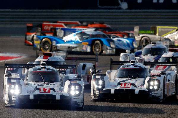 2015 FIA World Endurance Championship Bahrain 6-Hours Bahrain International Circuit, Bahrain Saturday 21 November 2015. Timo Bernhard, Mark Webber, Brendon Hartley (#17 LMP1 Porsche AG Porsche 919 Hybrid) leads Romain Dumas, Neel Jani, Marc Lieb (#18 LMP1 Porsche AG Porsche 919 Hybrid) and Marcel F?ssler, Andr? Lotterer, Beno?t Tr?luyer (#7 LMP1 Audi Sport Team Joest Audi R18 e-tron quattro) at the start. World Copyright: Alastair Staley/LAT Photographic ref: Digital Image _79P0092