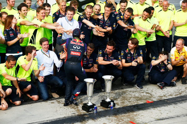 Hungaroring, Budapest, Hungary. Sunday 27 July 2014. Daniel Ricciardo, Red Bull Racing, 1st Position, and the Red Bull team celebrate victory. World Copyright: Andy Hone/LAT Photographic. ref: Digital Image _ONY2841