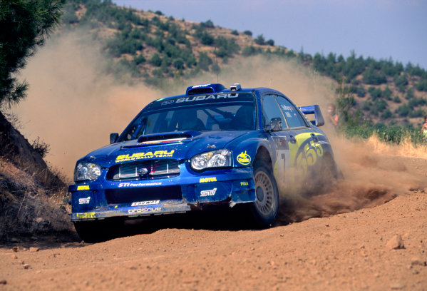 2003 World Rally ChampionshipRally of Cyprus, Cyprus. 19th - 22nd June 2003.Rally winner Petter Solberg/Philip Mills (Subaru Impreza WRC 2003), podium.World Copyright: McKlein/LAT Photographicref: 03WRCCyprus16