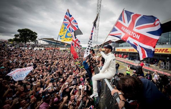 Silverstone, Northamptonshire, UK.  Sunday 16 July 2017. Lewis Hamilton, Mercedes AMG, 1st Position, celebrates victory with the British fans. World Copyright: Dunbar/LAT Images  ref: Digital Image _X4I8569