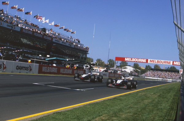 Albert Park, Melbourne, Australia. 6th - 8th March 1998.David Coulthard allows Mika Hakkinen (both McLaren MP4/13 Mercedes-Benz) into the lead. They finished in 2nd and 1st positions respectively, action.World Copyright: Charles Coates/LAT Photographic.Ref: 98AUS02.