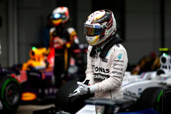 Sepang International Circuit, Sepang, Kuala Lumpur, Malaysia. Saturday 28 March 2015. Pole man Lewis Hamilton, Mercedes AMG, arrives in Parc Ferme. World Copyright: Andrew Hone/LAT Photographic. ref: Digital Image _ONZ9921