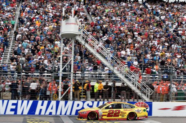 19-21 September, 2014, Loudon, New Hampshire USA Joey Logano takes the checkered flag and the win ?2014, Nigel Kinrade LAT Photo USA