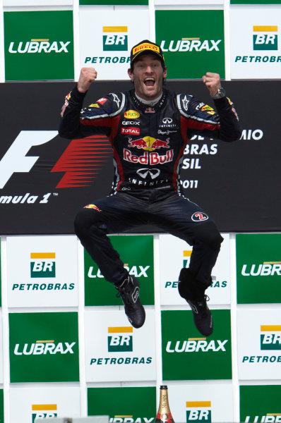 Interlagos, Sao Paulo, Brazil. 27th November 2011. Mark Webber, Red Bull Racing RB7 Renault, 1st position, celebrates victory. Portrait. Podium.  World Copyright: Steve Etherington/LAT Photographic ref: Digital Image SNE28293